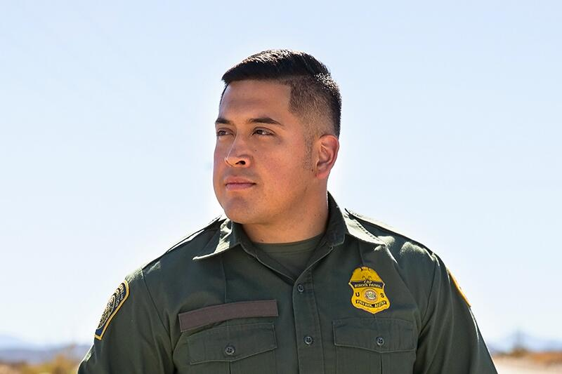 Portrait of Male Border Patrol Agent who is standing in the desert