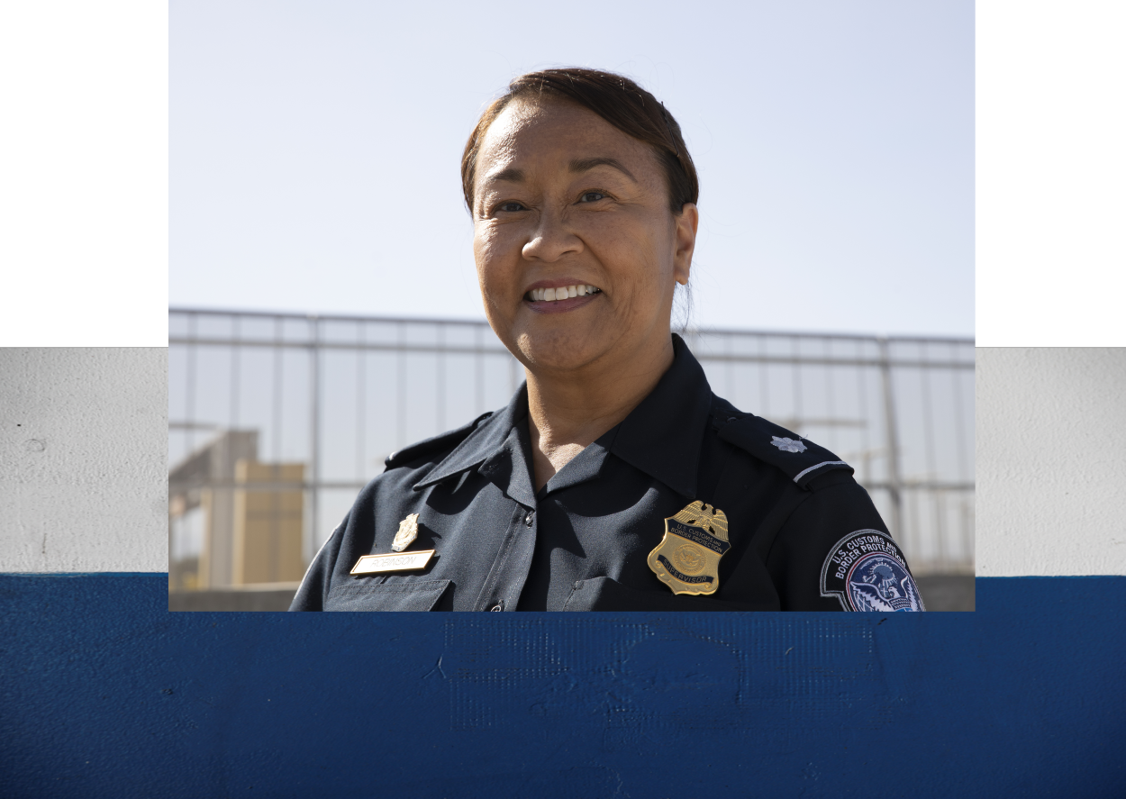 Female CBP Officer layered over top of a textured image of cargo containers