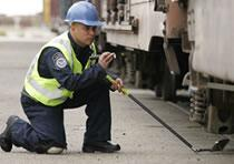 CBP Officer Inspecting Rail Cars