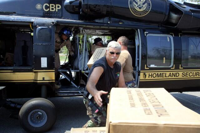 Photo of CBP distributing meals ready-to-eat