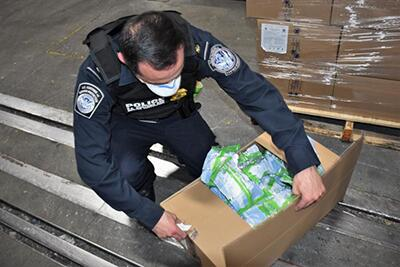 CBP officer inspects a shipment of personal protective equipment