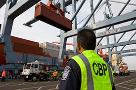 During the coronavirus pandemic, the U.S. borders have remained open for legitimate trade. A CBP officer at the busiest cargo seaport in the nation, Los Angeles-Long Beach in California, awaits a cargo container.