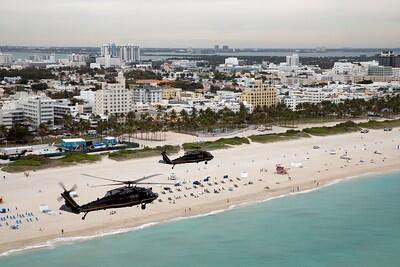 UH-60 Black Hawk helicopters assigned to the Customs and Border Protection's Air and Marine Operations patrol the airspace in advance of Super Bowl LIV in Miami, Jan. 27. Photo by Jerry Glaser