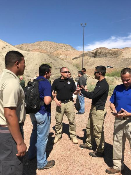 Attaché Michael Vargas (second from right) and Mark Bazill, CBP's Latin America and Caribbean Division director (third from right), brief Panamanian Immigration and Border Police officers on U.S. Border Patrol Operations at the border in El Paso Sector. Photo courtesy of Michael Vargas