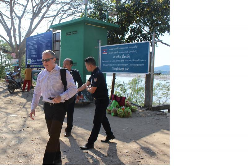 Attaché Robert Thommen evaluates interdiction training for two Laos customs officials at Tonphueng Port, a remote Mekong River border crossing opposite Burma. Photo courtesy of Robert Thommen