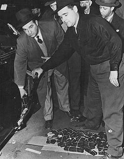New York Customs officers removing gold bars found concealed in the fender of Saul Chabot's vehicle. (CBP historical collections, 1951)