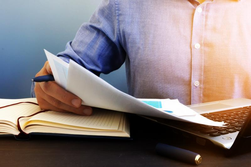 Auditor checking financial report