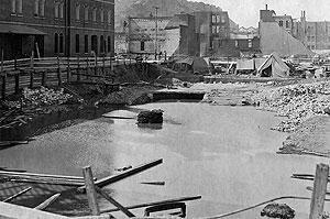 Excavated construction site for the San Francisco Customhouse collected water which was used to fight the fire that followed the earthquake.