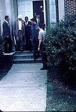 James Meredith is escorted by Federal officials to register for classes at the University of Mississippi. Copyright Estate of Donald James Proehl.