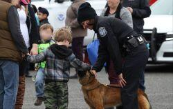 CBP Officer and canine visiting with kids at Family Outreach Event in Blaine Washington