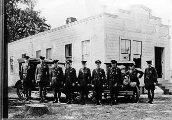 Historical photograph of Houlton Sector Border Patrol Agents lined up in front of the Sector Headquarters.