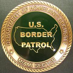 Front side image of the Miami Sector Challenge Coin