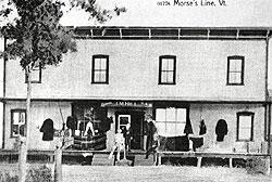 J. Morse's line store when under the later proprietorship of J.M. Hill, Jr. The store, which gave the hamlet the name Morses Line, straddled the international boundary at Morses Line Road. This postcard photo is from A History of Franklin, 1789-1989.