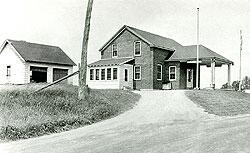 1940's photograph of the U.S. Customs and U.S. Immigration border inspection station at Morses Line, Vt. The border station was built in 1935 on the west side of Morses Line Road (State Route 235), and contained a small office on the first floor plus residential quarters for the Customs and Immigration officers stationed at the port.