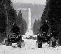 Border Patrol Agents patrolling the northern border on snowmobiles