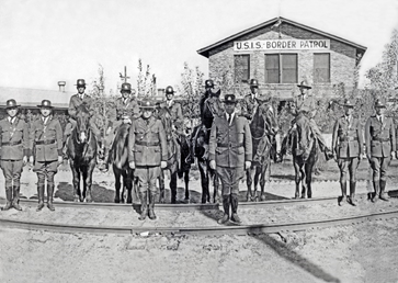 U.S. Immigration Service Border Patrol inspectors in formation in front of the Border Patrol's first training facility in Camp Chigas.