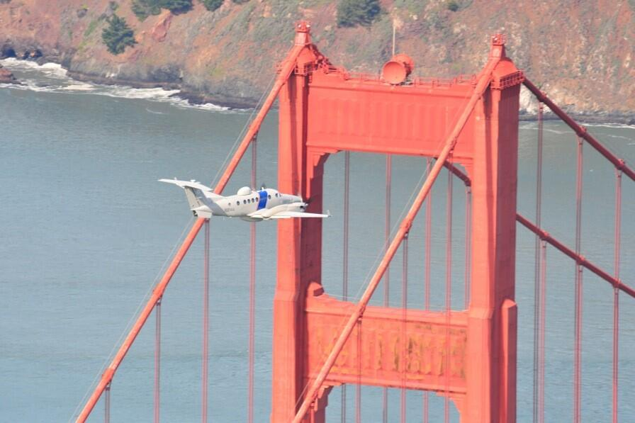 An MEA crew flies overhead during preparations for Super Bowl 50.