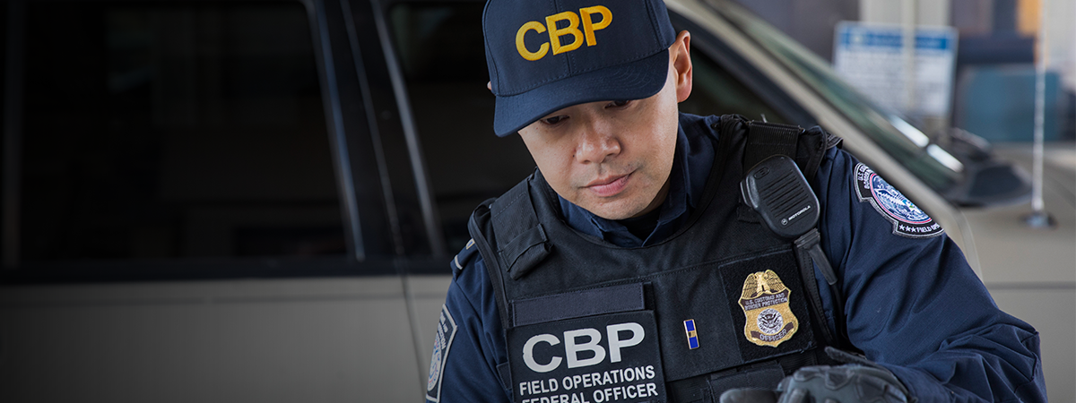 CBP officer inspects a vehicle