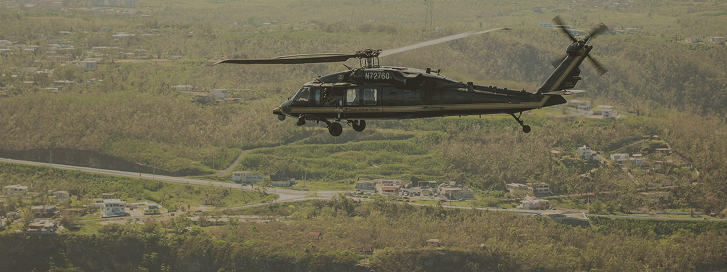 An Air and Marine Operations UH-60 crew surveys damage in Puerto Rico following Hurricane Maria.