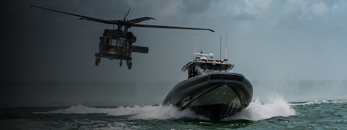 Air and Marine Agents in a UH-60 Blackhawk and marine vessels provide security around the waters of southern Florida.