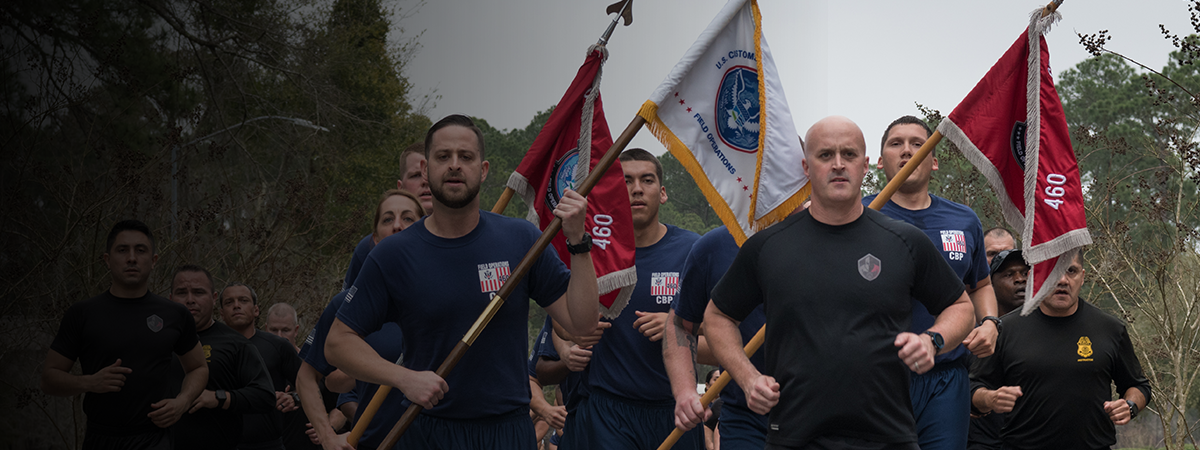 Field Operations Academy Director leads graduating class on final run.