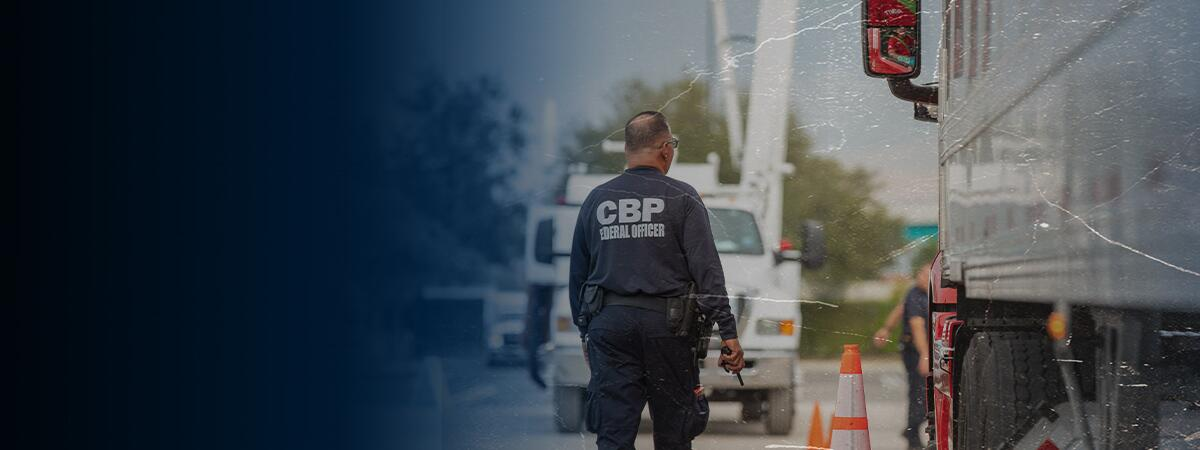 Photograph of CBP officer at a cargo inspection site