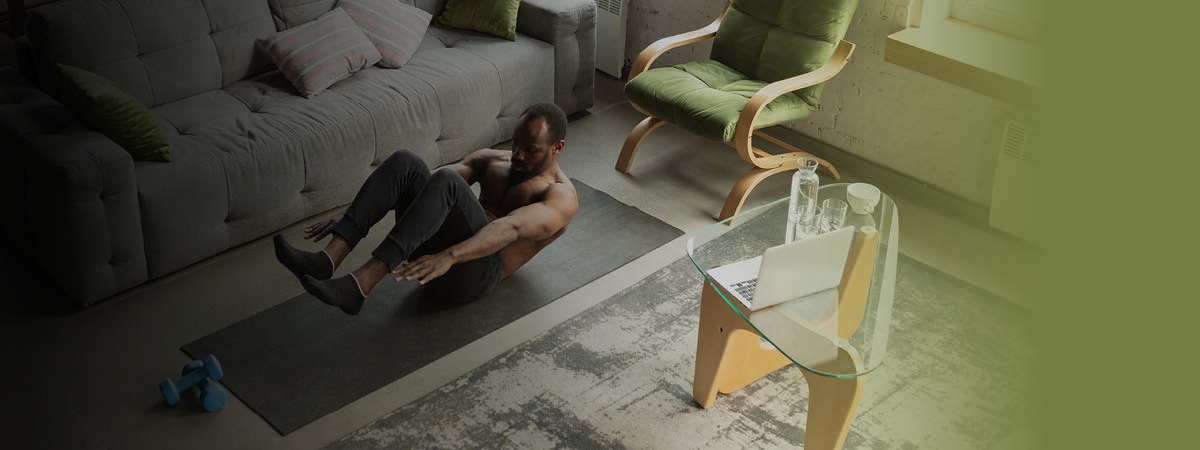 Man doing exercises in his living room