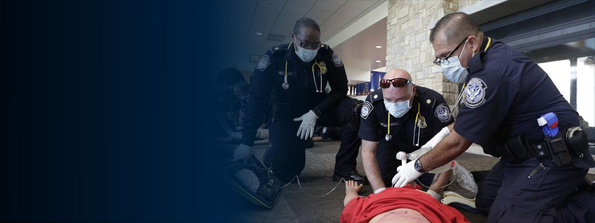 CBP emergency medical technician students perform a class exercise using a bag valve mask to resuscitate a simulated patient