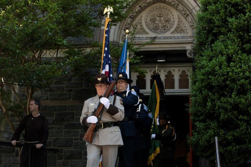 Supervisory Air Interdiction Agent April Peterson leads CBP's honor guard from St. Patrick's Church.