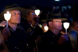 Acting Deputy Commissioner Ronald Vitiello (left) and U.S. Border Patrol Acting Deputy Chief Scott Luck (right) reflect on the fallen during the reading of names at the 29th Annual Candlelight Vigil.
