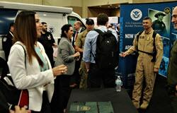 CBP members work the agency's booth during the Border Security Expo
