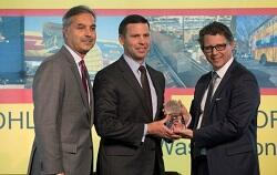 Kevin K. McAleenan accepts award from DHL representatives