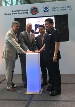 Photo of Commissioner Kerlikowske with dignitaries in Singapore