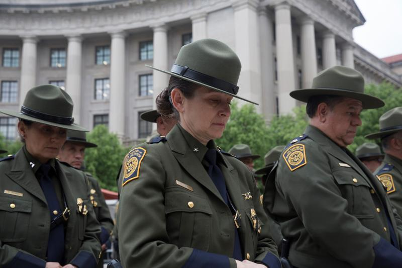U.S. Border Patrol agents bow their heads in reverence during the annual Valor Memorial and Wreath Laying Ceremony Wednesday in Washington, D.C.