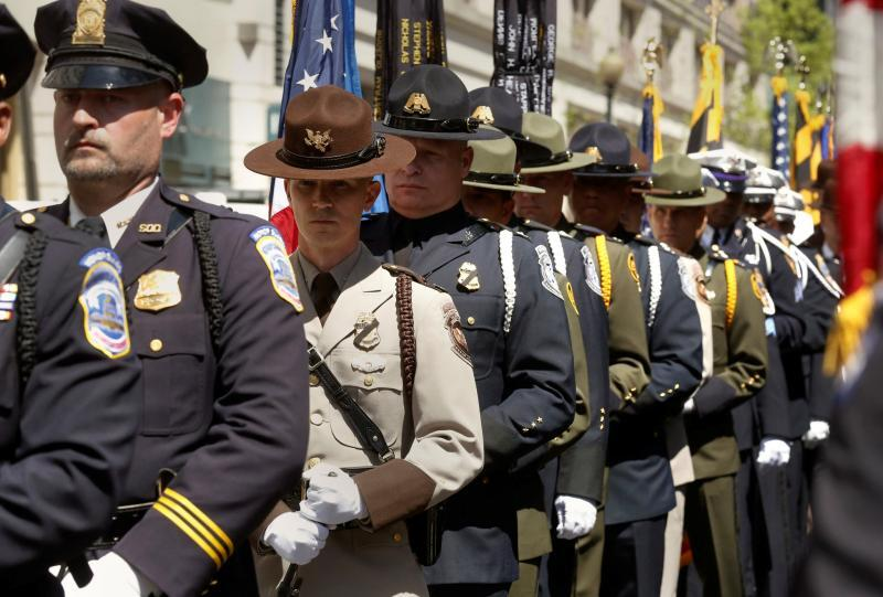 CBP personnel marching with their law enforcement partners leading to Blue Mass. Photo by Glenn Fawcett