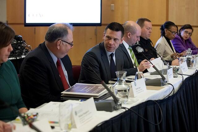 CBP Commissioner Kevin K. McAleenan, center right, confers with Deputy Assistant Treasury Secretary Timothy Skud at the 15th term COAC meeting on February 27.  From left, DHS Deputy Assistant Secretary Christa Brzozowski, CBP Executive Director of Trade Relations Bradley Hayes, CBP Executive Assistant Commissioner Office of Field Operations Todd Owen, CBP Deputy Executive Assistant Commissioner Office of Trade Cynthia Whittenburg, and CBP Deputy Executive Director of Trade Relations Valarie Neuhart.