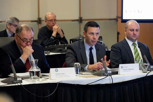 CBP Commissioner Kevin K. McAleenan, center, delivers his opening remarks at the February 27, 2019 COAC meeting in Washington, D.C.  Foreground from left, Treasury Deputy Assistant Secretary Timothy Skud and CBP Executive Director of Trade Relations Bradley Hayes.