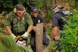 USBP and Field Operations Officers clear debris