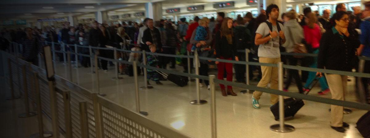 International visitors waiting in line at the airport