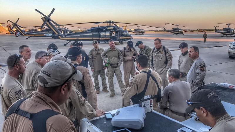 CBP Air and Marine Operations aircrews attend a morning briefing at Kelly Air Force Base in San Antonio prior to starting operations to support Hurricane Harvey relief efforts on August 30. Photo Courtesy of CBP