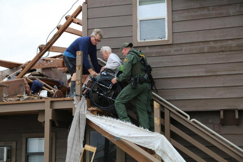 Rio Grande Valley Sector Border Patrol Special Operations Agents assist a disaster survivor trapped on the second floor of his home in Rockport, Texas August 26, 2017.  Photo courtesy of U.S. Customs and Border Protection