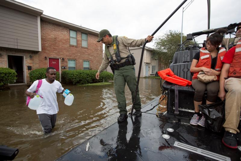U.S. Border Patrol riverine agents evacuate residents from a flooded Houston neighborhood after Hurricane Harvey August 30. Photo Credit: Glenn Fawcett
