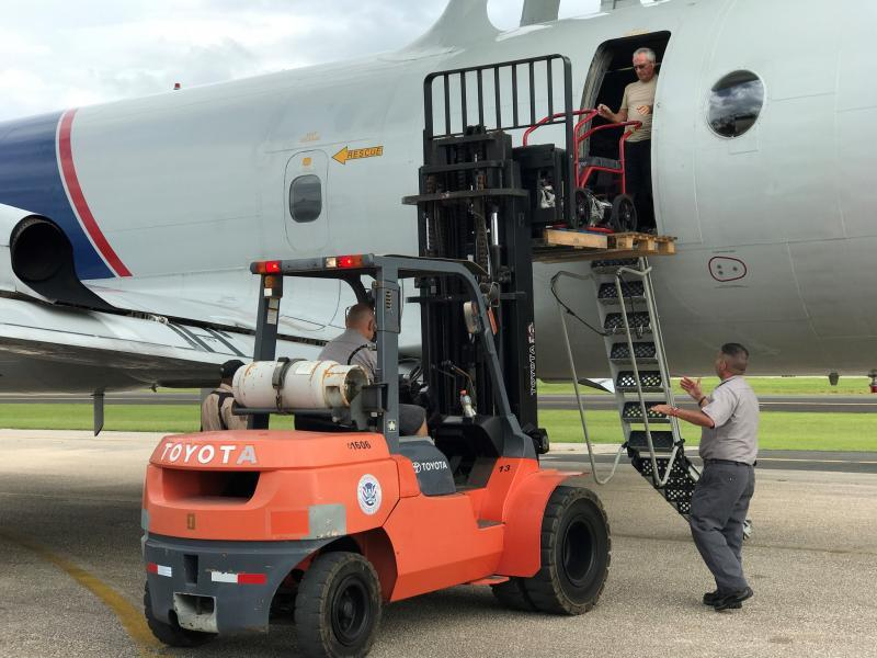 Urgently needed generators are loaded on an AMO P-3 destined for Aguadilla, Puerto Rico. Photo Credit: Carlos Rivera