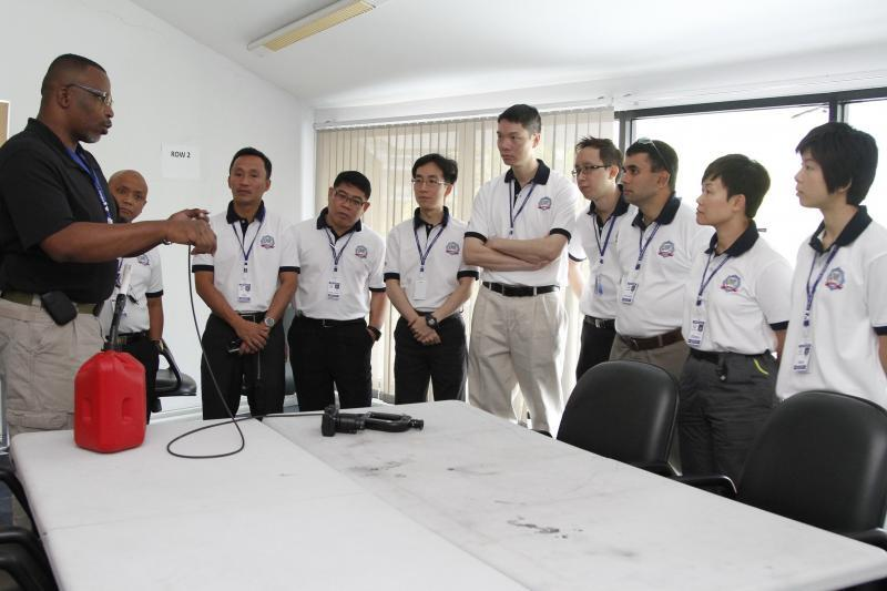Instructor demonstrating how to use a fiber optic scope to Thailand Custom Officers