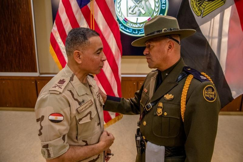 Mahmoud Hassenin, Egyptian defense attaché to the U.S. and Carlos Ortiz, U.S. Border Patrol Academy acting deputy chief patrol agent, confer during the Egyptian border guard graduation.