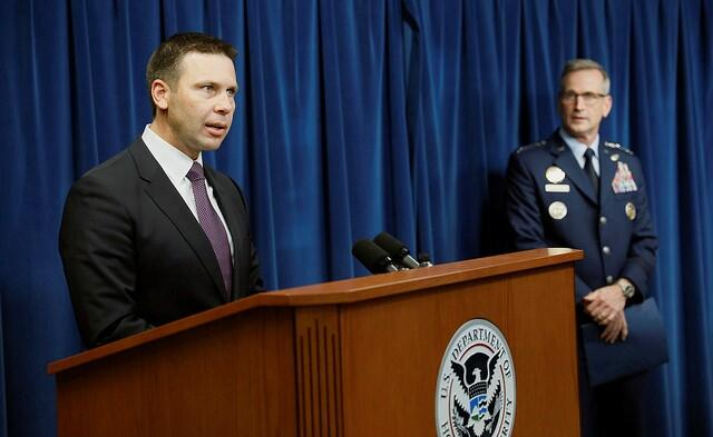 U.S. Customs and Border Protection Commissioner Kevin McAleenan (foreground),Commander, United States Northern Command and North American Aerospace Defense Command General Terrence John O'Shaughnessy (background), and Assistant Secretary of Defense for Homeland Defense and Global Security Kenneth P. Rapuano (not pictured) hosted a joint press conference at CBP Headquarters in Washington, D.C., on October 29, 2018. CBP Photo by Glenn Fawcett