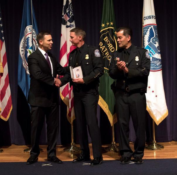 Commissioner McAleenan (left), along with Acting Deputy Commissioner Robert Perez, congratulate Vernon Foret, area port director, Office of Field Operations, New Orleans, with the Leadership Award. Foret was one of eight CBP personnel recognized Oct. 10 at the Commissioner's Annual Awards Ceremony. Photo by Jaime Rodriguez