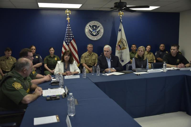 Vice President Mike Pence (center), Homeland Security Secretary Kirstjen Nielsen (right) and CBP Acting Commissioner Kevin McAleenan (far right) meet with Border Patrol agents, CBP officers, Air Interdiction agents, and other federal and local law enforcement officials during a roundtable discussion at the Hidalgo, Texas Port of Entry. The meeting was part of the Vice President's visit to South Texas which includes a tour of the border wall and a ride along with U.S. Border Patrol agents on the Rio Grande. DHS photo by Jetta Disco