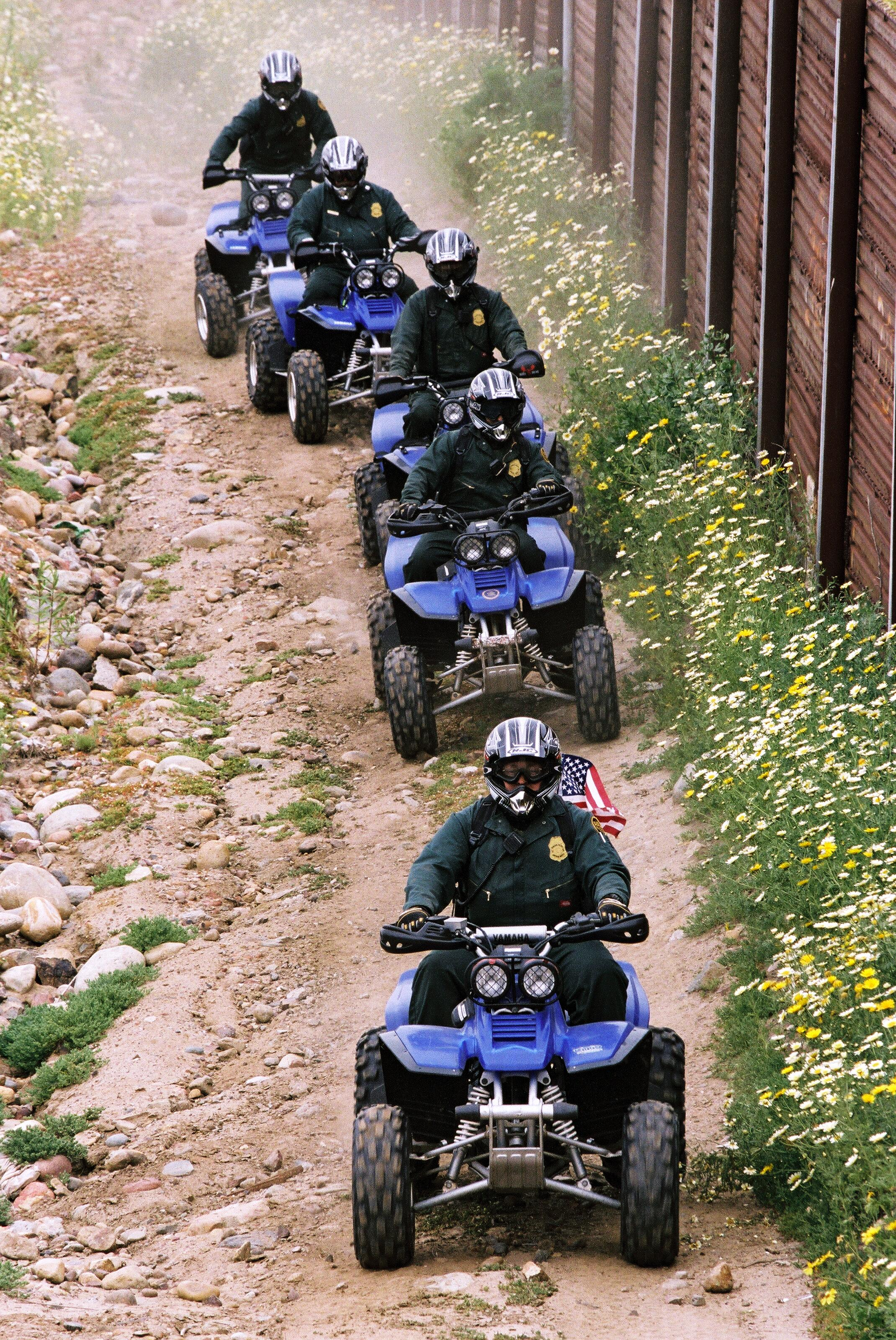 Border Patrol agents makes use of All Terrain Vehicles to patrol along the rugged border with Mexico.