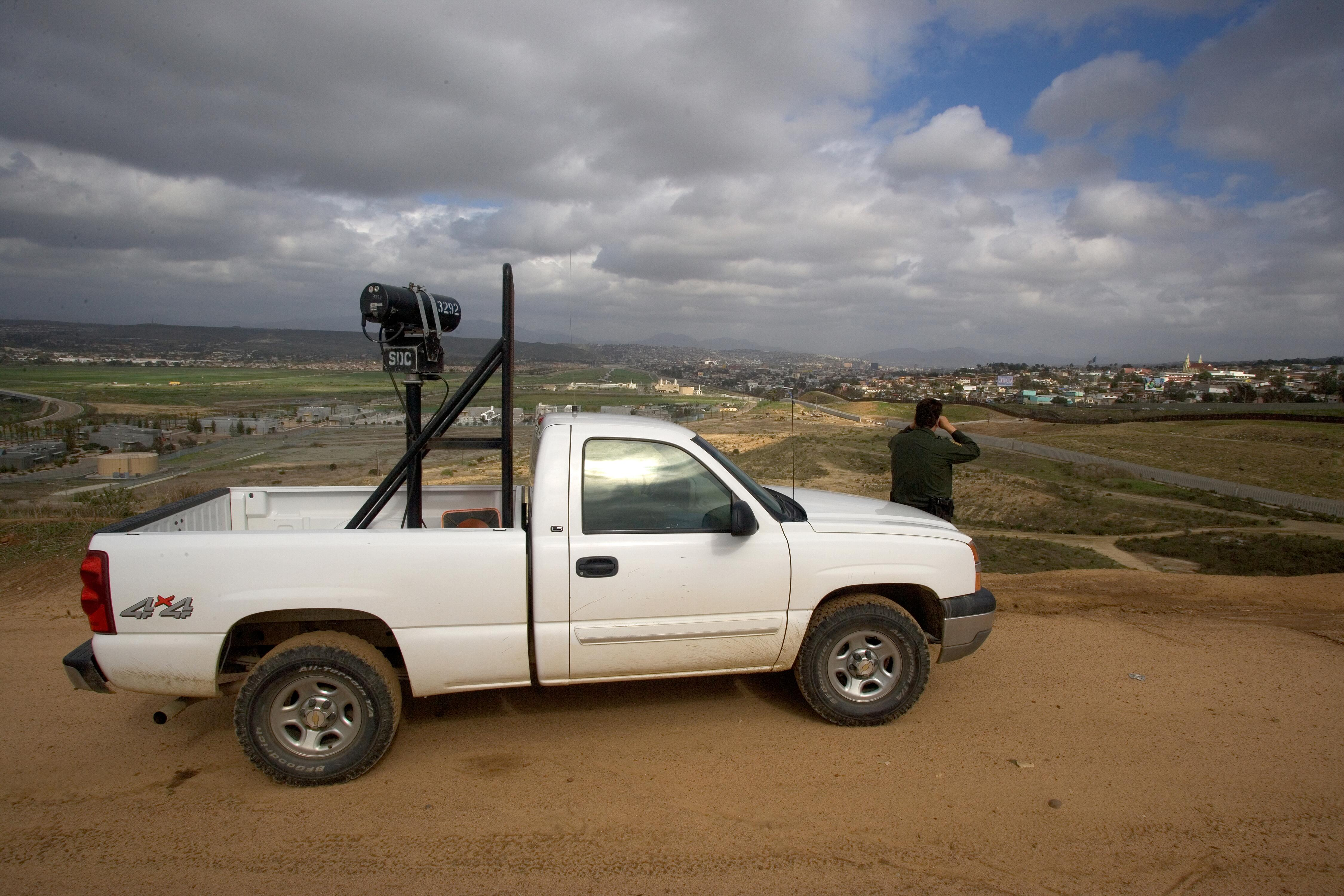 U.S. Border Patrol agent scans Imperial Valley area for signs of illegal crossings.